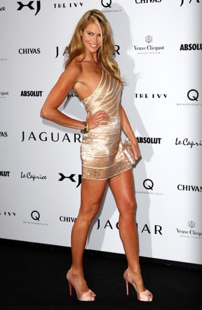Elle Macpherson Jaguar XJ Launch Herve Leger camile dress Louboutin heels