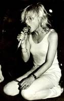 blondie on stage vest jeans mic
